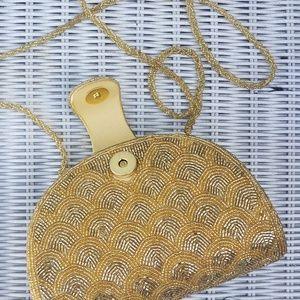 Gold beaded clutch bag